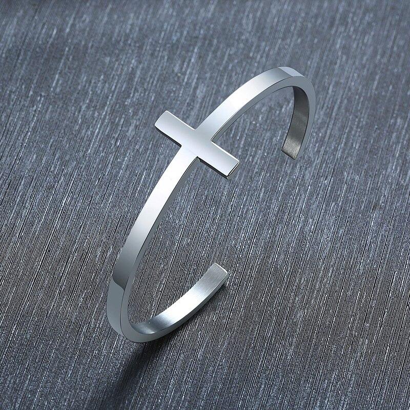 Браслет серебристого цвета с крестом