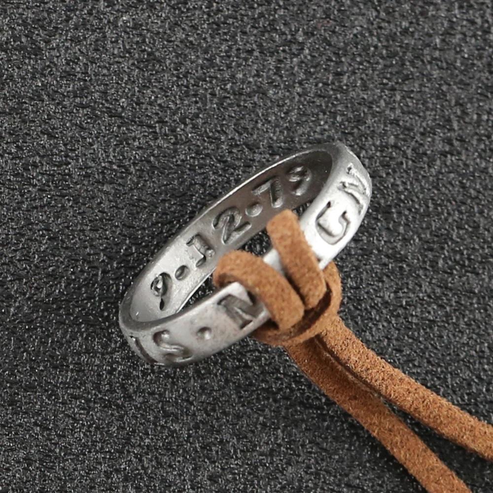 Кольцо на коричневом шнурке из кожи