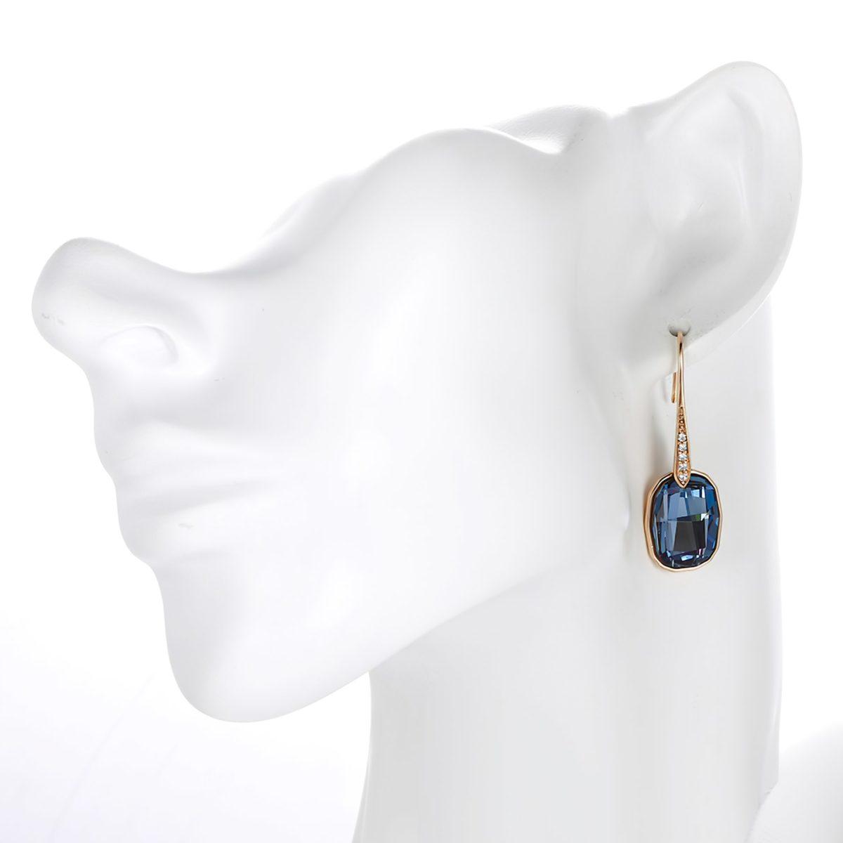 Золотистые серьги с синим кристаллом